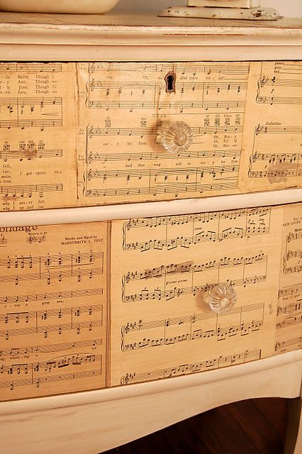 "Redecorate a dresser front with old sheet music. ""Antique"" the sheet music with strong tea. Just paint it on."