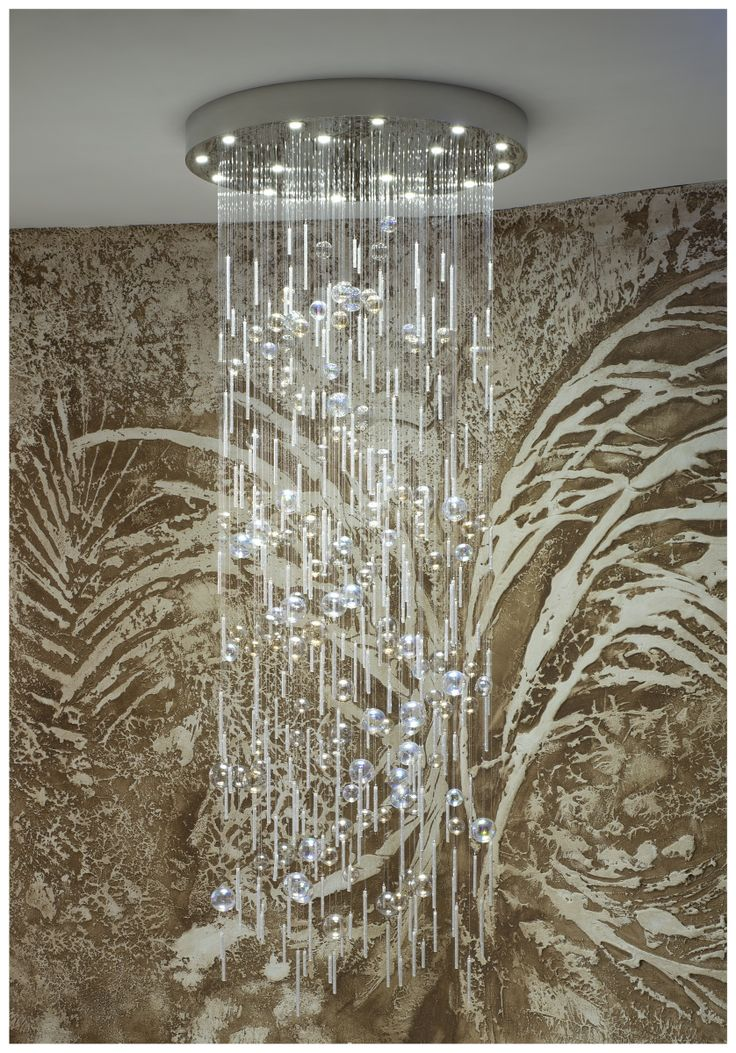 Modern chandelier made of hand blown glass and crystals hanging on sparkling fiber optics. Serial production.