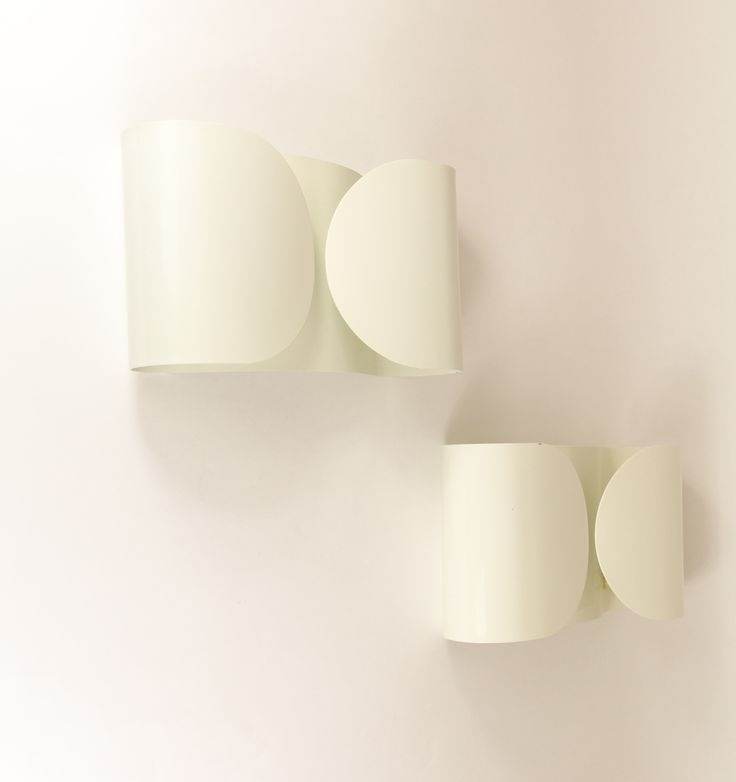Two original Foglio wall lamps designed by Tobia Scarpa for Flos in 1966.