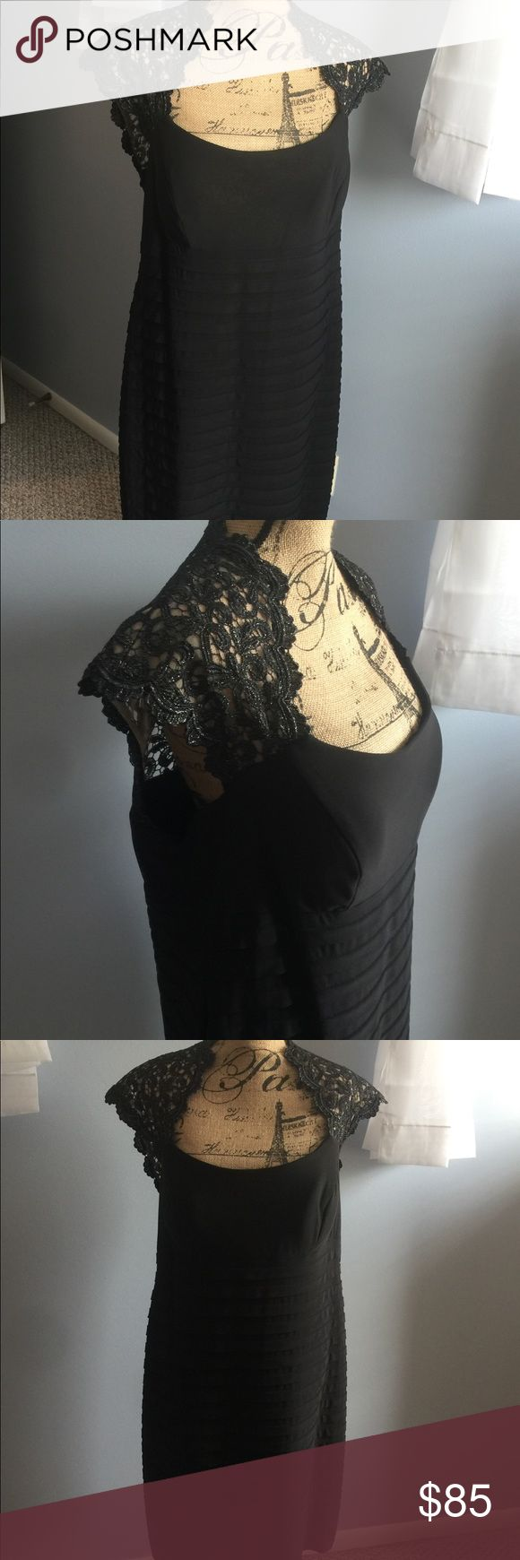 🎉🍾NYE🎉Xscape NEW w tags formal dress size 18w Xscape NEW with tags woman's formal dress,size 18w, black lace and silver caped sleeves and back, nude lined, skirt has horizontal pleats for a slimming effect, material is stretchable and comfortable, has hidden zipper, knee length. This dress is super gorgeous on and much prettier than the pictures show. New with tags and in perfect condition. Xscape Dresses Wedding
