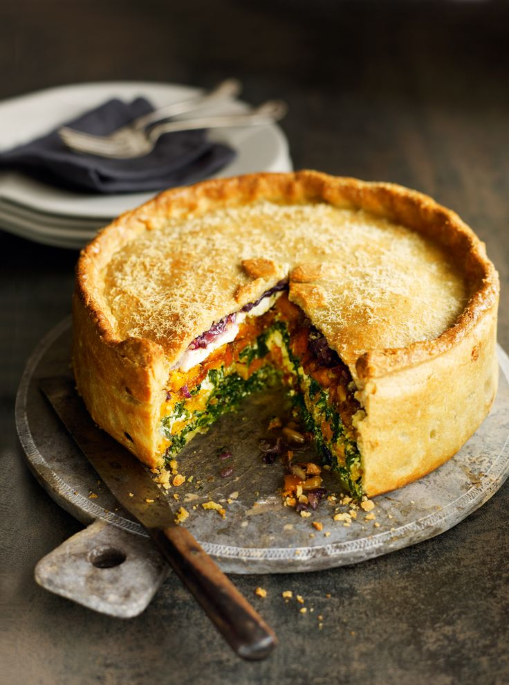 This autumnal vegetarian pie recipe is made with roasted butternut squash, spinach and goat's cheese in a cheesy pastry. The pie is freezable so you can make it ahead.