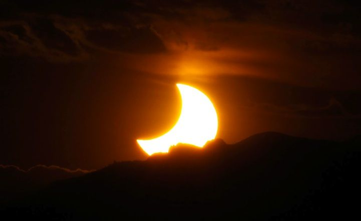 Solar Eclipse Photos 2012.Rocky Mountains, seen from downtown Denver, Colorado.