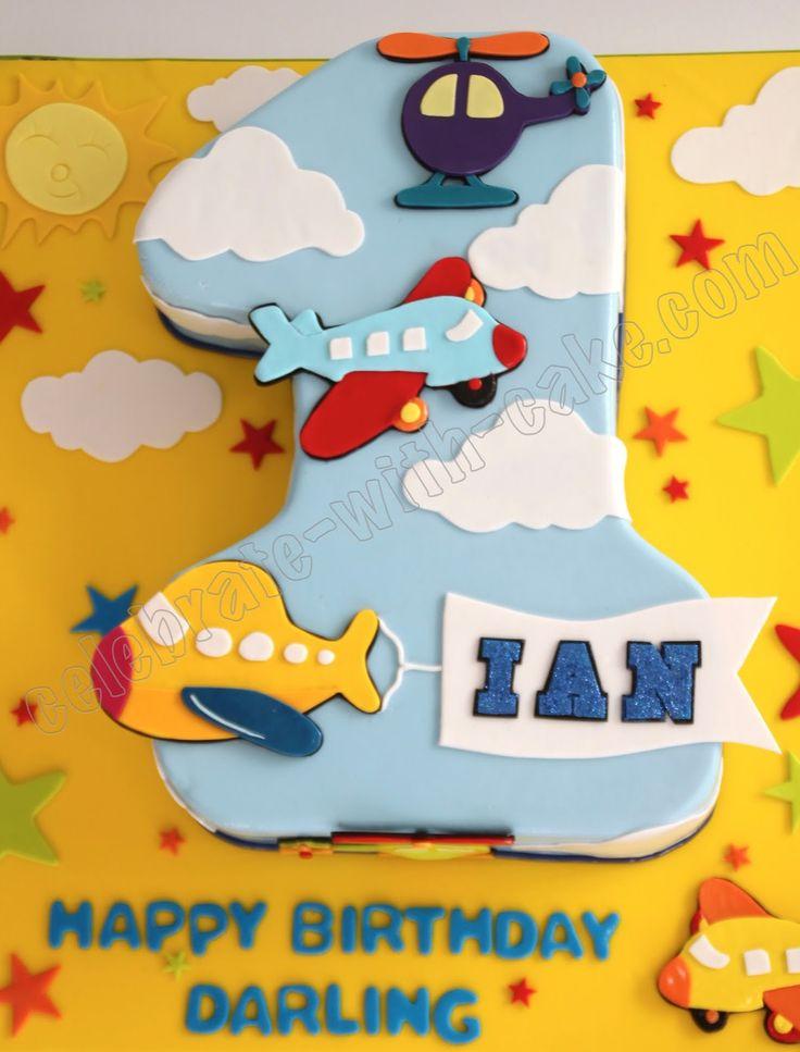 Transportation-themed first birthday cake.