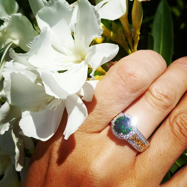 Silver Halo Ring with Green and Clear CZ with Gold plate, also has a matching necklace and earrings to complete the look.