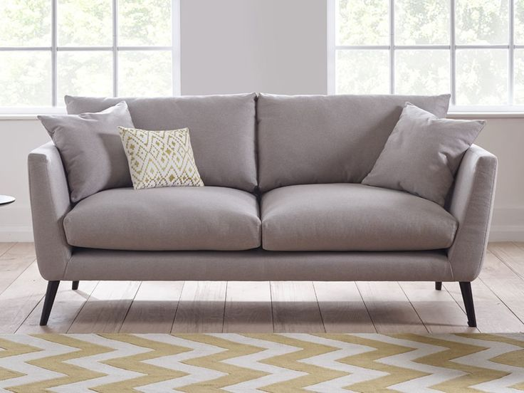 Marcy Sofa - The retro feet and high armrests reveal a fun vintage styling whilst plush padded cushions and luxurious European fabrics make this sofa the ideal marriage of comfort and style - by www.livingitup.co.uk
