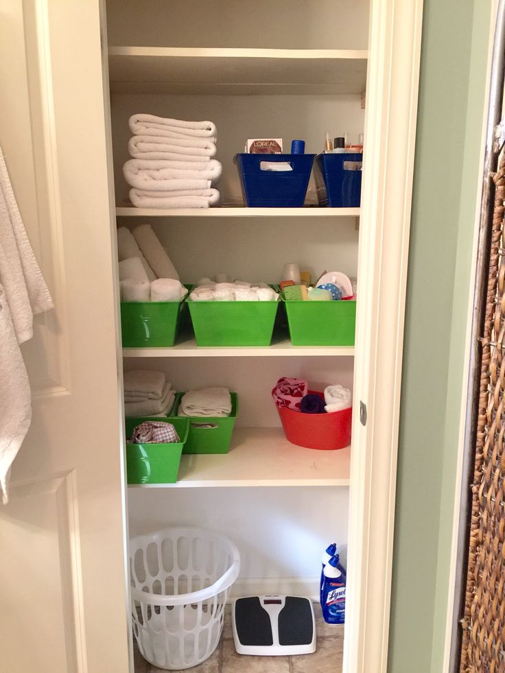 Use dollar tree containers to organize your linen closet