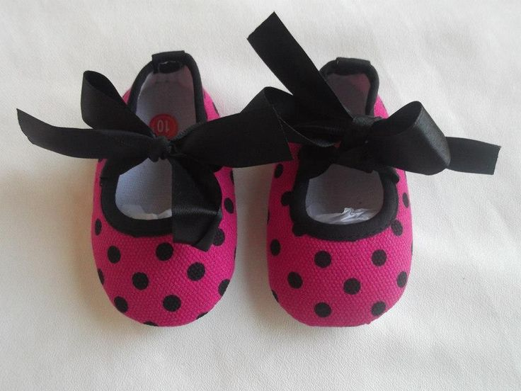 Raindrops and Raspberries Pink / Black Polkadot shoes Gorgeous soft soled baby shoes with a satin ribbon tie.  Shoes available in sizes   3-6 months (10cm) 6-12 months (11cm) 12-18 months (12cm) 18-24 month (13cm) Please note shoe measurements and measure against baby's foot before purchasing.  Visit: http://www.thehivenz.co.nz/raindrops-and-raspberries-baby.html for more information on how to purchase and other great items