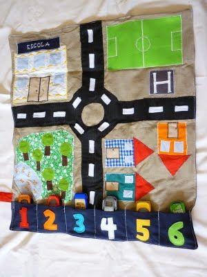 "car play mat - I love that this has places to ""park"" your cars!"