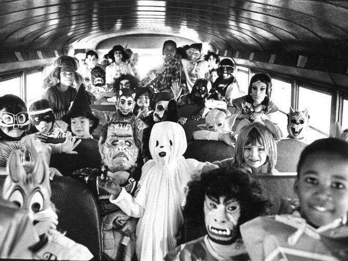 Kids dressed for Halloween, on the school bus. What a great photo!