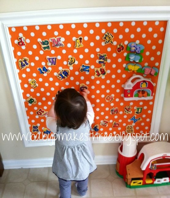 Super cute idea for a playroom! DIY magnet board - 1 sheet of galvanized metal (comes in a lot of different sizes in the plumbing section) wall trim or frame. Cover in fabric.