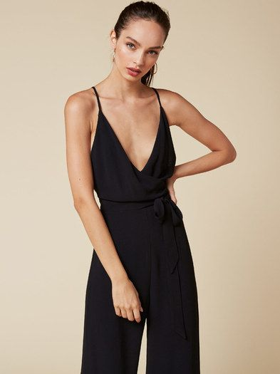You're Bianca Jagger. This is a wrap jumpsuit with a v neckline and cross-back straps.