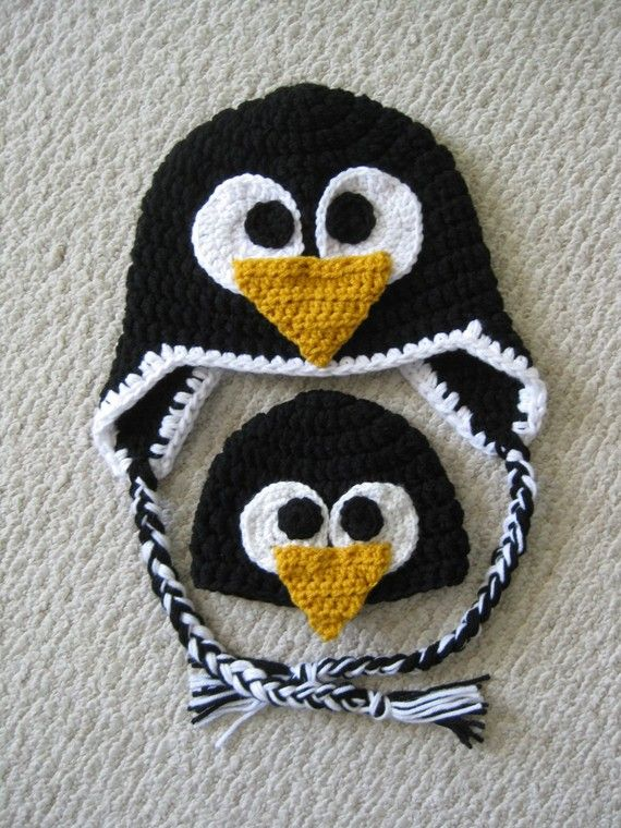Crochet Penguin Hat... made one kind of like these CUTIES, I just added flippers, lil orange feet that hang from under the bottom of the earflaps,  a lil black  white pom pom to the top of its head, for my lil penguin!  So CUTE!  :)