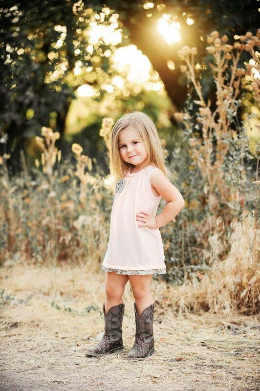 I need to get my little girl some boots for the rodeo!! Can't forget the hat too!! She's so adorable!