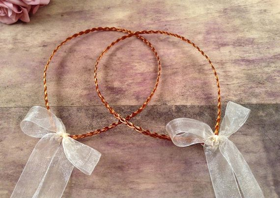 Simple stefana in a traditional design.  Made with sweet red copper metal. At the back side there are organza ivory ribbons and bows.
