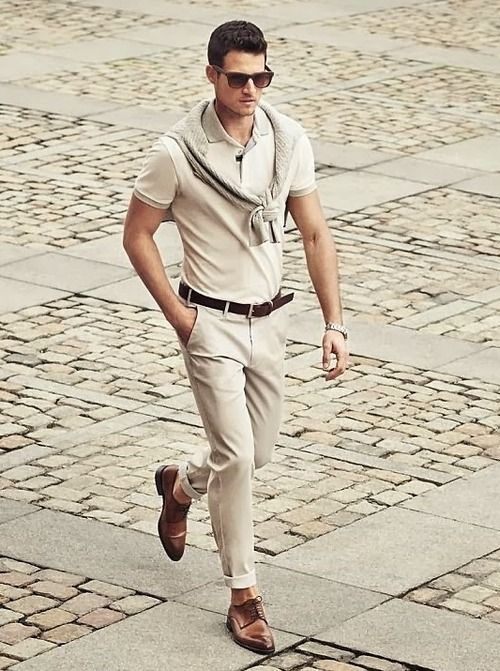 Busy days call for a simple yet stylish outfit, such as a beige crew-neck sweater and nude chinos. Brown leather derby shoes will bring a classic aesthetic to the ensemble. Shop this look on Lookastic: https://lookastic.com/men/looks/crew-neck-sweater-polo-chinos-derby-shoes-belt-sunglasses-watch/10413 — Dark Brown Sunglasses — Beige Polo — Beige Crew-neck Sweater — Dark Brown Leather Belt — Silver Watch — Beige Chinos — Brown Leather Derby Shoes