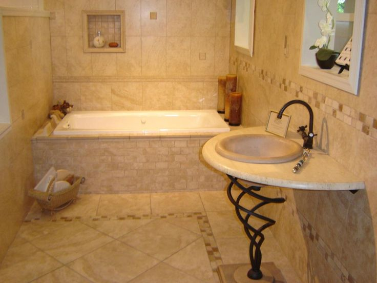I love the wrought iron pedestal sink and the fact that the sink can hold a soap dispenser.