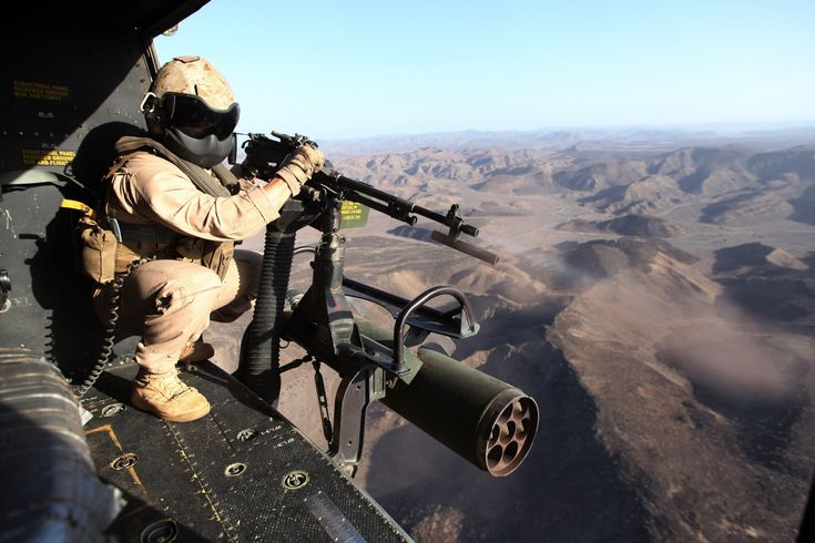 Sgt. Ryan D. Peek, a UH/AH-1 helicopter mechanic and Lubbock, Texas, native, with Marine Medium Tiltrotor Squadron 365 (Reinforced), 24th Marine Expeditionary Unit, fires a mounted M240B machine gun from a UH-1Y Huey in Djibouti, March 8, 2015. A contingent of the MEU was ashore in Djibouti conducting sustainment training to maintain proficiency at the beginning of March. The 24th MEU is embarked on the ships of the Iwo Jima Amphibious Ready Group.