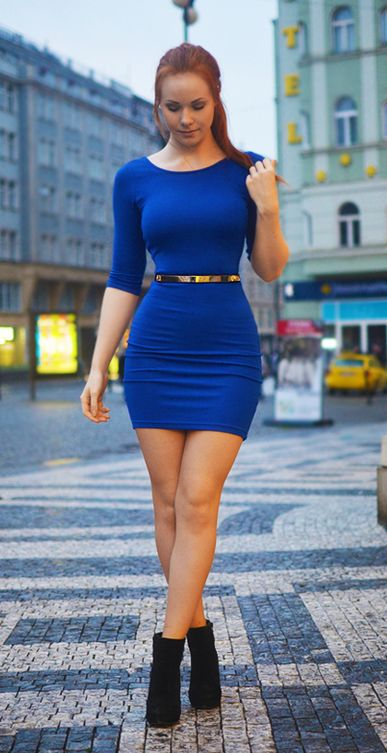 Hot babe in a tight blue dress that accentuates her gorgeous hips.