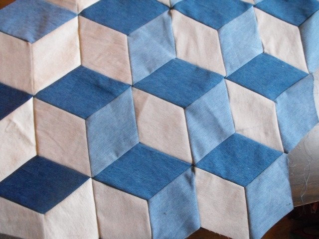 This is an unfinished project of tumbling block design made from up cycled denim jeans.  Still in process.
