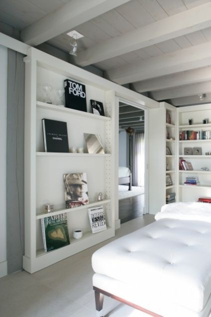 A sliding bookshelf door doesn't even need the space to swing.