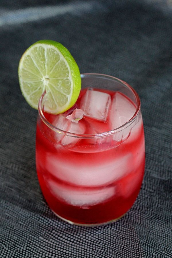 Vodka Cranberry cocktail drink recipe with cranberry juice, vodka, Rose's lime and a dash of orange juice.