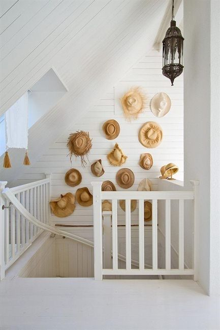 Straw Hat Wall Decor...Very cute idea for a Beach home...and don't plan on wearing them again. The moist air stretches them when you hang like that. (Not that you could where they hang here)