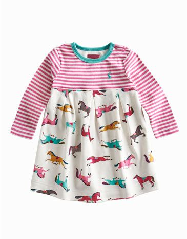 Joules null Baby Girls Dress, Creme Pony.                     She'll love wearing this soft cotton jersey dress, so it's just as well we've made it one of our comfiest yet. Fit for numerous visits to the washing machine and bursting with colour thanks to the stripes and hand-drawn prints.