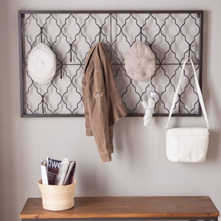 Quatrefoil iron wall plaque with hooks wall shelves hooks at hayneedle