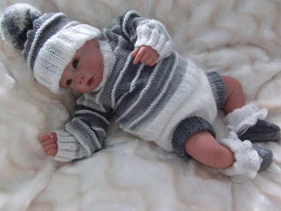 The knitting pattern gives full instructions for this lovely easy to knit outfit.  It will fit a 18-22 reborn or a 0-3 month baby.