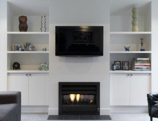Built in shelving with tv/fireplace pillar