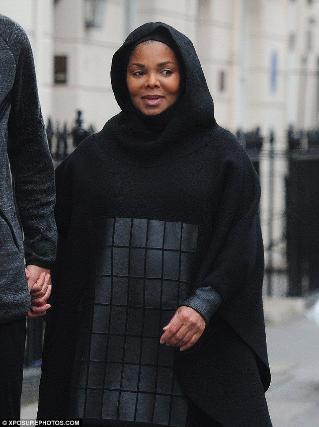 Steal from the boys like Janet in a Y-3 poncho   Click 'visit' to buy it now  #DailyMail