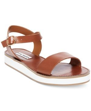 Bring stylish lift to your look from the beach to city streets in Steve Madden's Deluxe sandals fashioned in a simple strappy design and crisp white platform.   Leather upper; manmade sole   Imported