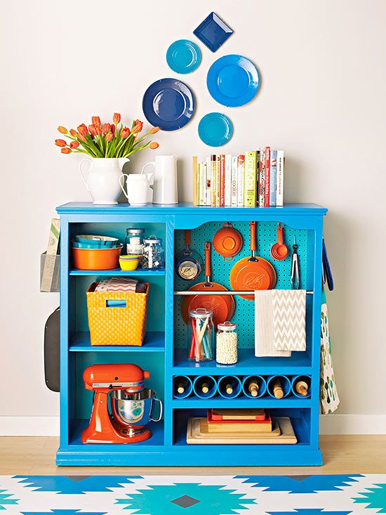 There are easy DIY ways to upgrade basic organization items to gain even more usefulness. Bookshelves or an old TV cabinet, for example, take on whole new layers of practicality when outfitted with inserts and add-ons -- here, pegboard to keep pots and pans in sight, a bar for towels, and pipes to hold wine bottles. Add baskets and hooks on the sides for additional spots to stash necessities./