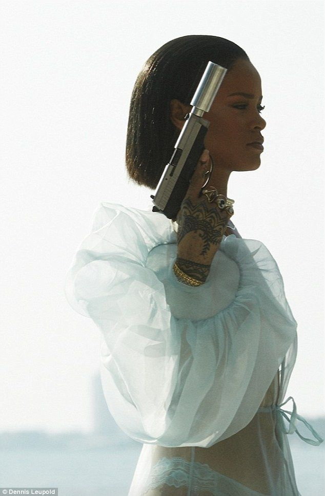 Good girl gone bad: Rihanna set pulses racing with scintillating photos before releasing her latest music video