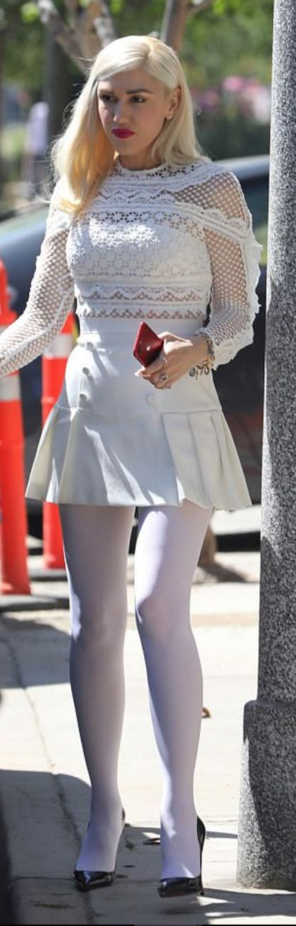 Who made  Gwen Stefani's black pumps and white lace long sleeve dress?