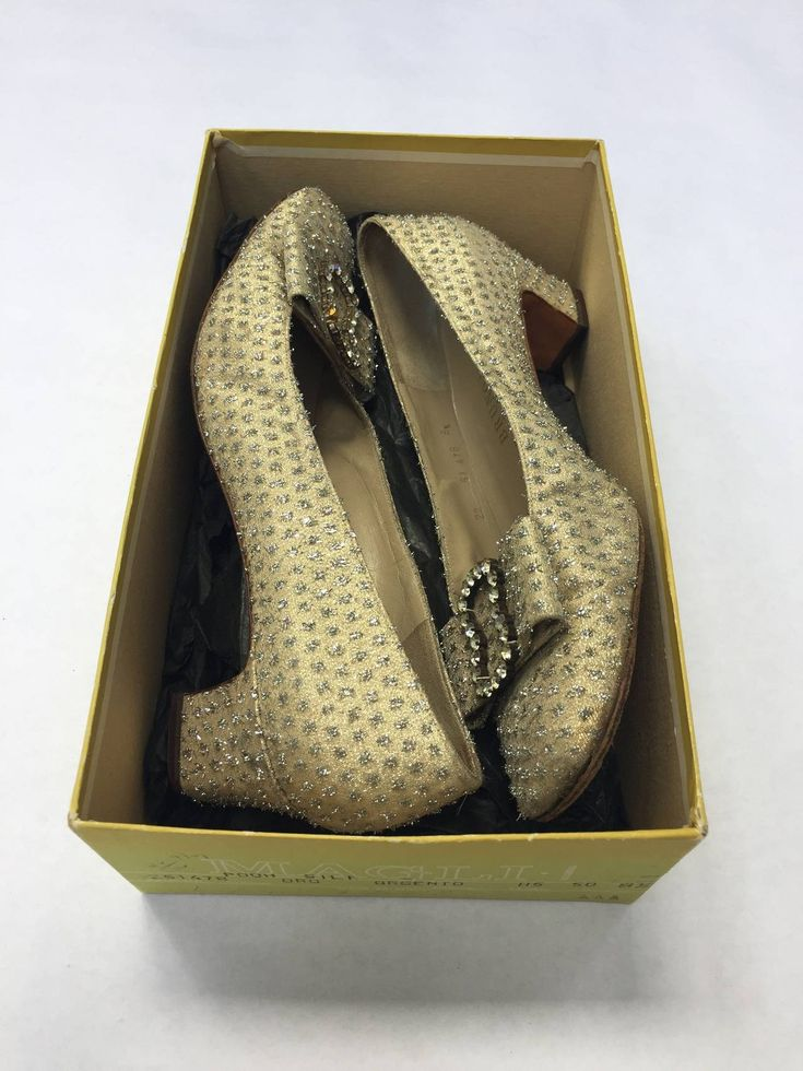 Bruno Magli 60s gold evening shoes size 8.5. | From a collection of rare vintage shoes at https://www.1stdibs.com/fashion/accessories/shoes/