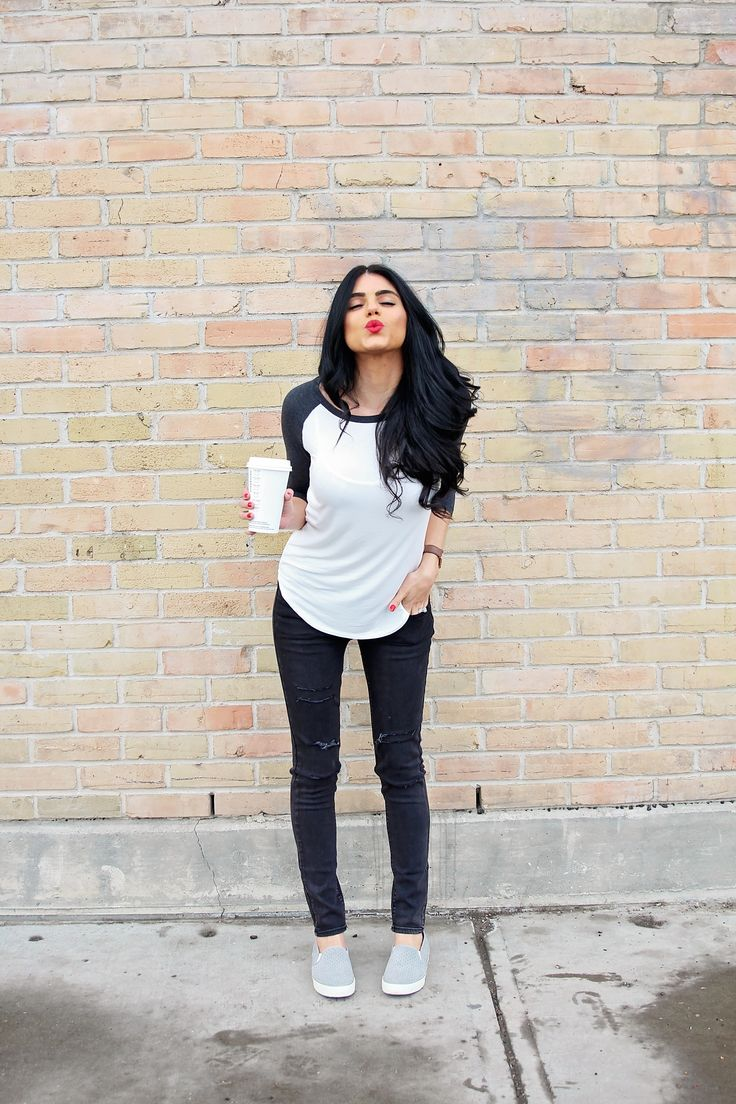 baseball tee, black ripped jeans, slip on shoes