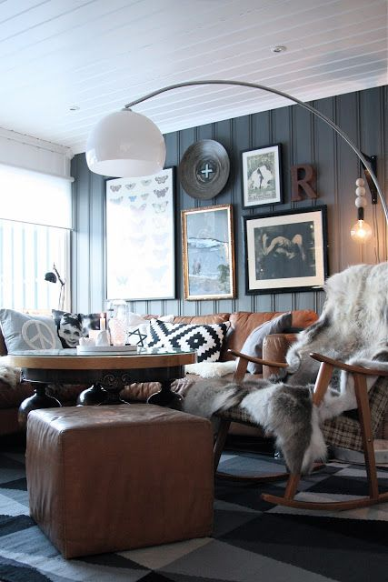LOVE the tall round coffee table and the black and white pillow! living illusion [norwegian] #leather #grey