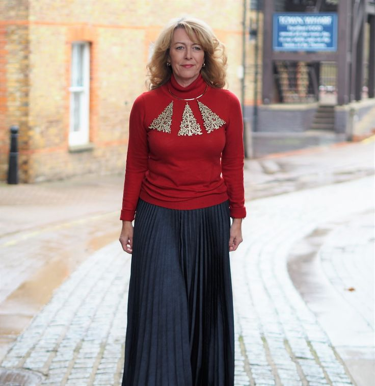 Over 50s fashion blogger Laurie Bronze from Vaity and Me in a stunning gold Christmas tree collar worn over a deep red jumper in the 5 Over 50 Christmas jumper challenge