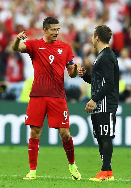 Robert Lewandowski of Poland and Mario Goetze of Germany talk after their scoreless draw in the UEFA EURO 2016 Group C match between Germany and Poland at Stade de France on June 16, 2016 in Paris, France.