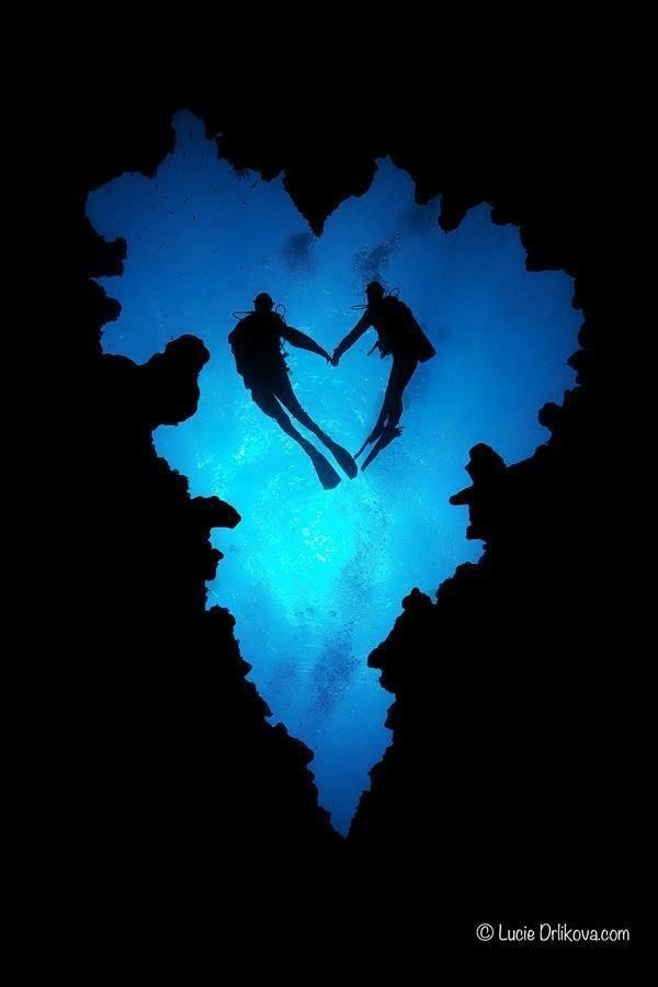 Heart-shaped divers in a heart-shape cave!