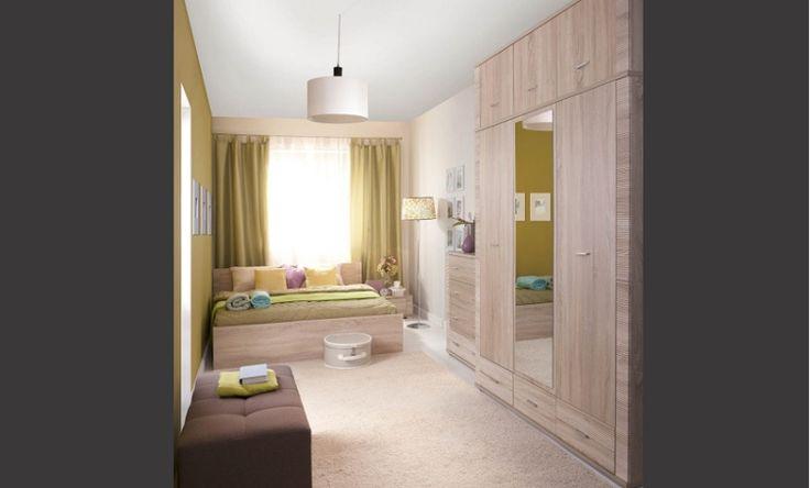 """Sypialnia GRESS, dąb sonoma  Duża, 3 - drzwiowa szafa może zostać dodatkowo powiększona o segment """"nadstawki"""", który w znaczący sposób powiększa pojemność mebla. Pionowe lustro dopełnia funkcjonalność tej bryły podnosząc codzienny walor użytkowy."""