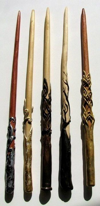I hope I picked the right category for this, They are more sculpture than woodworking, I think. The shaft of each wand is simply a dowl that I carved and sanded to a tip. Then I stained them differ...
