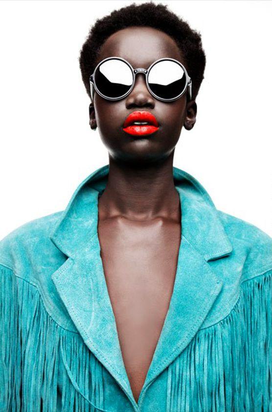 Teal fringe jackets, bright orange lipstick, and oversized sunglasses. Enough said.