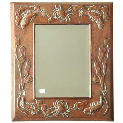 Arts & Crafts copper mirror with marine motifs by J&F Poole of Hayle, England c1900.  Marks: None  Dimensions: 15.75 x 13.5 inches