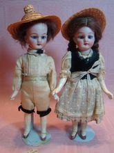 Pair of Matching German Bisque Head Dolls in Original Swiss Costumes