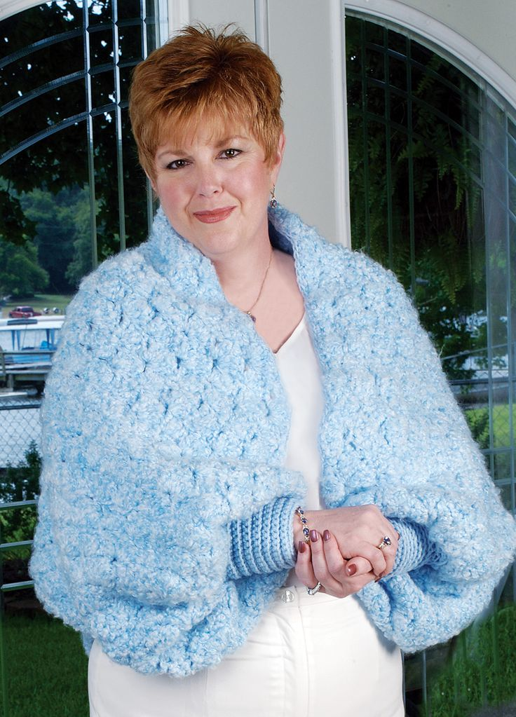 "Cozy Shell Shrug Design by Shirley Zebrowski Fluffy bulky weight yarn that's soft as a cloud creates the sumptuous texture and cozy comfort in this pretty, sky blue shrug that will wrap you in heavenly warmth! Skill Level: Beginner Size: 31-1/2 X 60"" Love the addition of cuffs to this shrug."