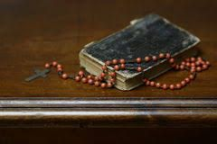 Image result for Rosary beads and prayer book