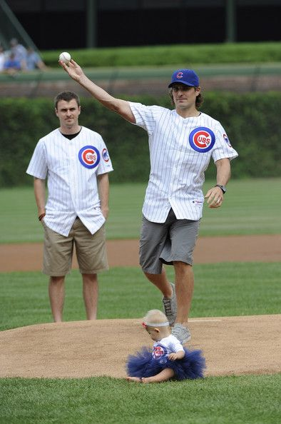 Patrick Sharp, of the Chicago Blackhawks, throwing out a pitch at a Cubs game.