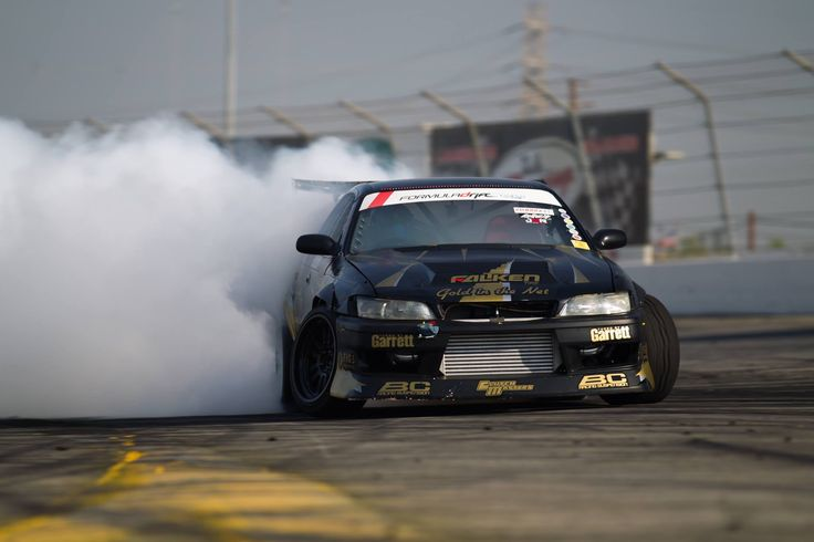 Action shot of the Gold in the Net Drift JZX90 from the last round of Formula Drift in Irwindale. Falken Tire, Clutch Masters, Turbo by Garrett, BC Racing Coilovers
